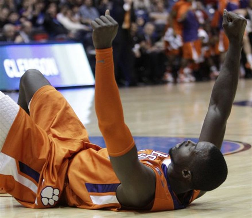Clemson guard Andre Young drives against UAB guard Aaron Johnson, left, in the first half of a first-round NCAA college basketball tournament game Tuesday, March 15, 2011, in Dayton, Ohio. (AP Photo)