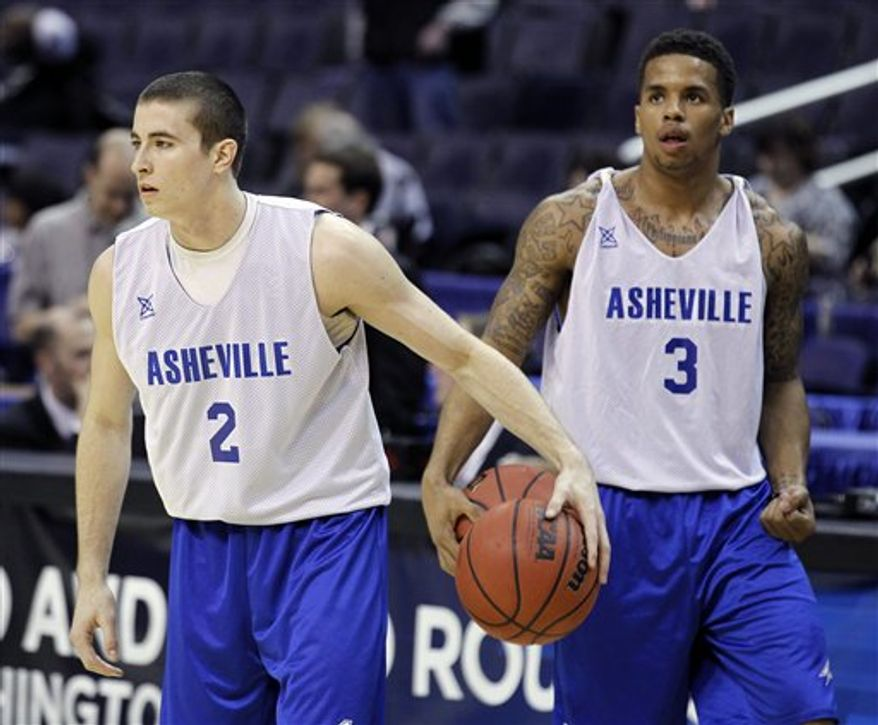 North Carolina-Asheville guard J.P. Primm, left, listens to coach Eddie Biedenbach during practice on Wednesday, March 16, 2011 in Washington, for their southeast regional NCAA college basketball tournament second round game against Pittsburgh on Thursday.(AP Photo)