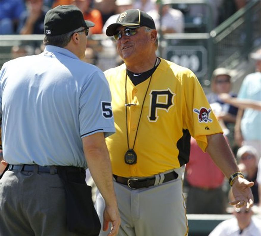 Pittsburgh Pirates manager Clint Hurdle, right, talks with home plate umpire Bill Welke after Pirates' Andrew McCutchen was called out attempting to score in the fifth inning of a spring training baseball game against the Baltimore Orioles in Sarasota, Fla., Monday, March 14, 2011. The Orioles won 8-2. (AP Photo)