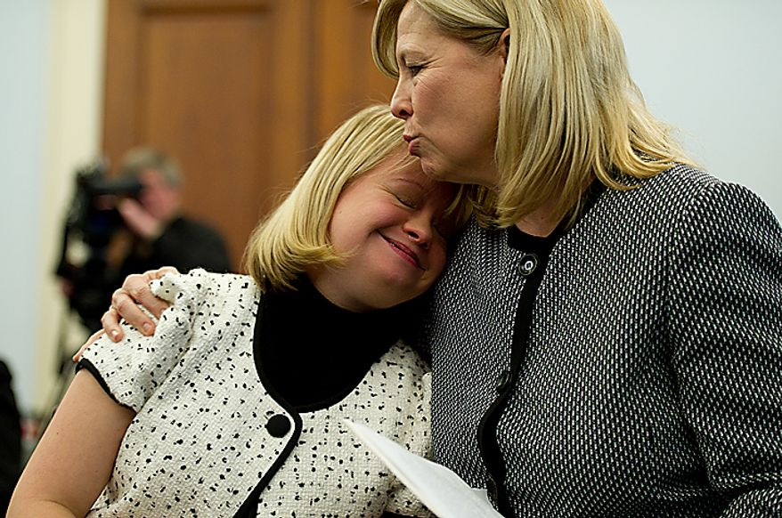 Robin Sinkhorn embraces her daughter Lauren Potter following Potter's statement at a Congressional briefing on Bullying of Children with Special Needs on Wednesday, March 16, 2011. Potter, an actress on the show Glee, who has Down Syndrome, spoke about her experiences growing up and being teased. (Barbara L. Salisbury/The Washington Times)