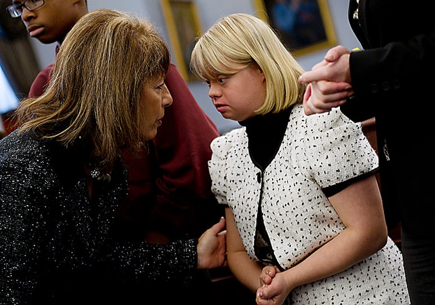 Rep. Jackie Speier (D-Calif.) leans over to talk to Lauren Potter, an actress on the show Glee, during a Congressional briefing on Bullying of Children with Special Needs on Wednesday, March 16, 2011. Ms. Potter, who has Down Syndrome, spoke about her experiences growing up and being teased. (Barbara L. Salisbury/The Washington Times)