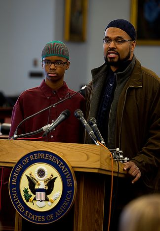 Isma'il Clayton, 13, and his father Kyle talk about Isma'il's experiences being bullied by his classmates because of his Asperger's Syndrome during a Congressional briefing on Bullying of Children with Special Needs Wednesday, March 16, 2011. Mr. Clayton is demanding a zero-tolerance policy on bullying in schools. (Barbara L. Salisbury/The Washington Times)