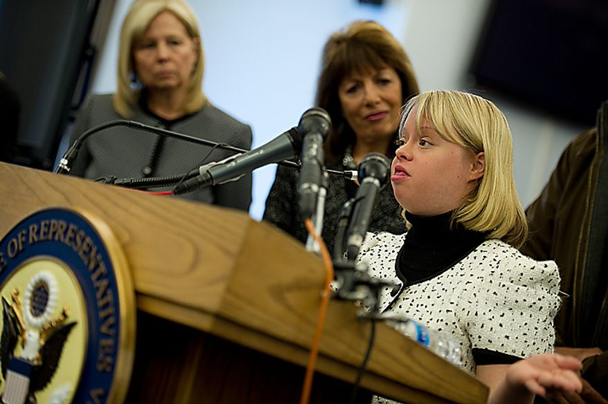 Lauren Potter, an actress on the show Glee, who has Down Syndrome, speaks about her experiences growing up and being teased during a Congressional hearing on Bullying of Children with Special Needs Wednesday, March 16, 2011 while her mother Robin Sinkhorn (far left) and Rep. Jackie Speier (D-Calif.) look on. (Barbara L. Salisbury/The Washington Times)
