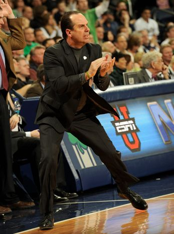 Notre Dame's basketball coach, Mike Brey, encourages his team during second-half play against Seton Hall University on Feb. 26 in South Bend, Ind. Notre Dame prevailed 60-48. (Associated Press)