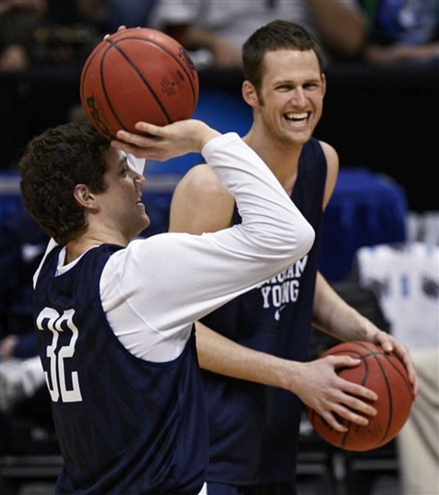 BYU's Jimmer Fredette dribbles during a practice session for their NCAA Southeast regional college basketball semifinal game Wednesday, March 23, 2011, in New Orleans. BYU plays Florida on Thursday, March 24. (AP Photo/Gerald Herbert)