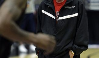 San Diego State head coach Steve Fisher watches his team during a basketball practice Wednesday, March 16, 2011, in Tucson, Ariz. San Diego State will face Northern Colorado in a west regional NCAA college basketball tournament second round game on Thursday. (AP Photo/Matt York)