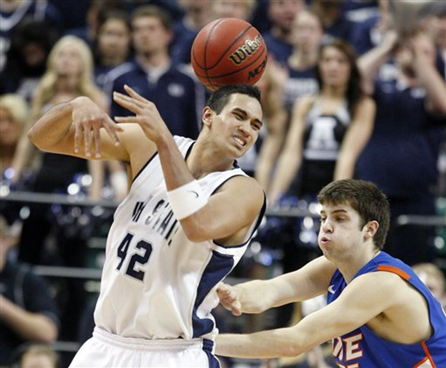 Utah State's Tai Wesley loses the ball covered by Boise State's Paul Noonan during the second half of an NCAA Western Athletic Conference tournament championship college basketball game Saturday, March 12, 2011, in Las Vegas. Utah State defeated Boise State 77-69. (AP Photo/Isaac Brekken)