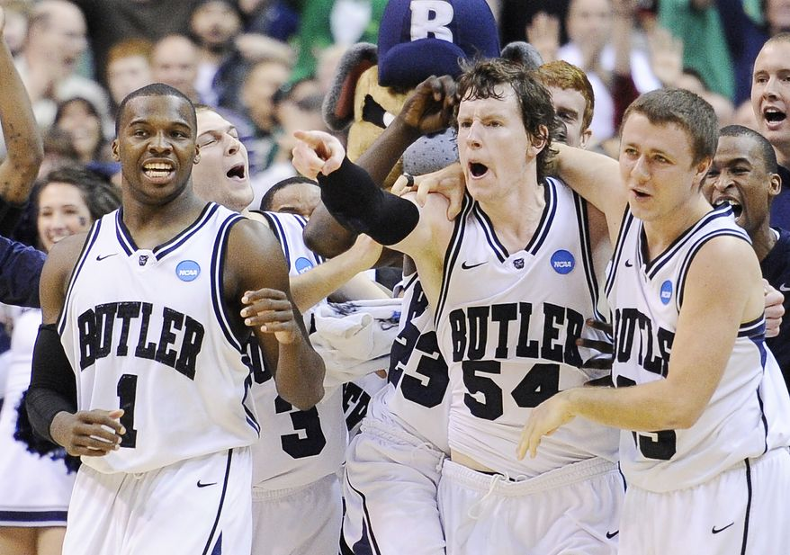 Butler players, from left, Shelvin Mack, Matt Howard, and Chase Stigall celebrate their 60-58 victory of Old Dominion in the Southeast regional second round NCAA tournament college basketball game, Thursday, March 17, 2011, at the Verizon Center in Washington. Howard scored a tip-in a the buzzer to give Butler the win. (AP Photo/Nick Wass)
