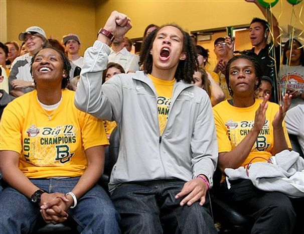 Baylor center Brittney Griner, left, listens to head coach Kim Mulkey at the end of a news conference before the NCAA women's college basketball tournament regional final, Monday, March 28, 2011, in Dallas.  Texas A&M will face Baylor on Tuesday. (AP Photo/LM Otero)