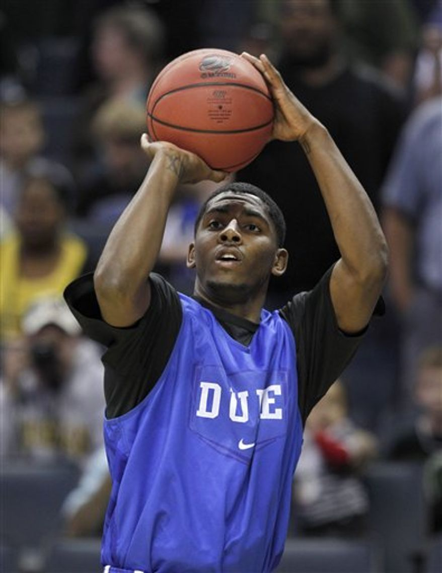 Duke's Nolan Smith, left, looks at Kyle Singler as he speaks during a news conference for a West regional semifinal in the NCAA college basketball tournament, Wednesday, March 23, 2011, in Anaheim, Calif. (AP Photo/Mark J. Terrill)
