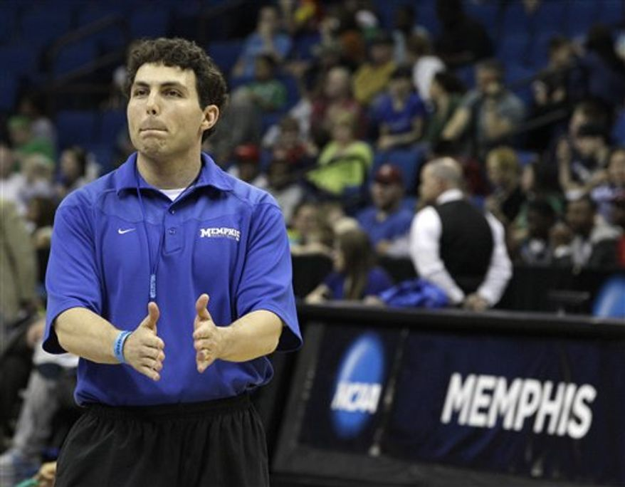 Memphis players celebrate after an assistant coach made a half court shot during practice for a West Regional second round NCAA tournament college basketball game in Tulsa, Okla., Thursday, March 17, 2011. (AP Photo/Charlie Riedel)