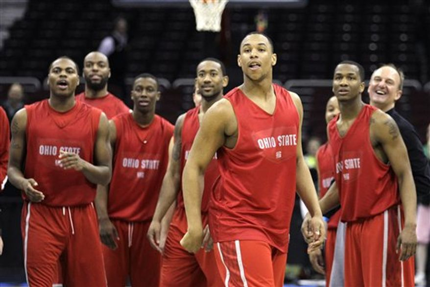 Ohio State's Dallas Lauderdale, left, and Jordan Sibert talk in the locker room after practice for an East Regional third round game in the NCAA college basketball tournament in Cleveland on Saturday, March 19, 2011.  Ohio State will face George Mason on Sunday.  (AP Photo/Amy Sancetta)