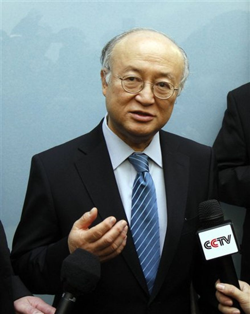 Director General of the International Atomic Energy Agency, IAEA, Yukiya Amano from Japan speaks to the media about the nuclear emergency triggered by the devastating earthquake and tsunami in Japan before his takeoff to Japan at Vienna's Schwechat airport, Austria, on Thursday, March 17, 2011. (AP Photo/Ronald Zak)
