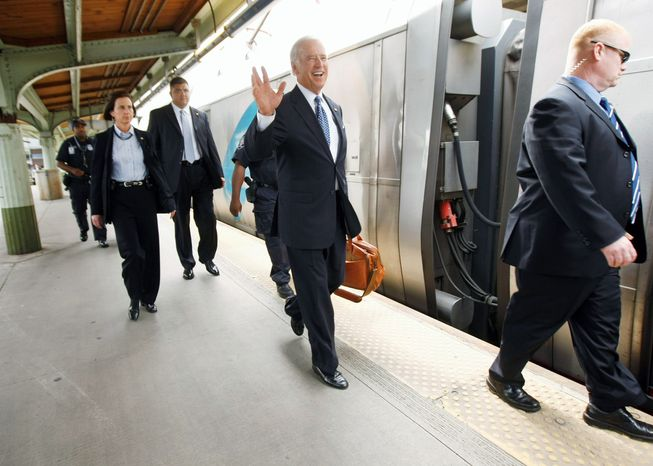 Vice President Joseph R. Biden (center) personally fought for stimulus funding to renovate the Amtrak station in Wilmington, Del. He used the station regularly as a senator, and Amtrak is renaming the station in his honor. (Associated Press)