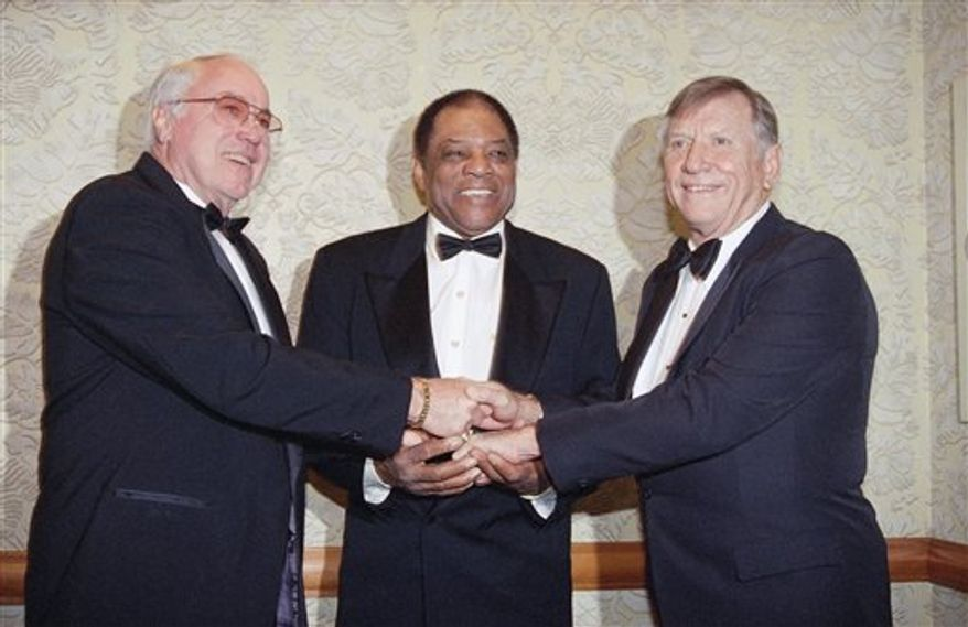 """FILE - This Jan. 22, 1995, file photo shows from left, Duke Snider, Willie Mays and Mickey Mantle joining hands as they pose at the New York chapter dinner of the Baseball Writers Association, in  New York. The Hall will honor """"Talkin' Baseball"""" composer and singer Terry Cashman this summer as part of induction weekend, 30 years after his song became a ballpark favorite.   (AP Photo/Eric Miller, File)"""