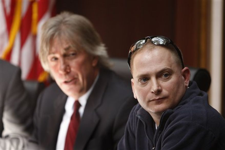"""FILE - In this March 3, 2010 file photo, attorney Geoffrey Fieger, left, and Master Sgt. Jeffrey Sarver are seen during a news conference in Southfield, Mich. Sarver, a bomb disposal expert who served in the Iraq war filed a lawsuit against the makers of the film """"The Hurt Locker."""" (AP Photo/Carlos Osorio, file)"""