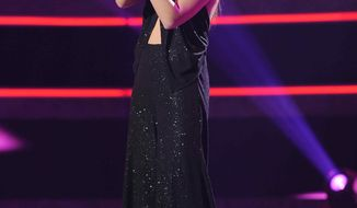 "In this publicity image released by Fox, Karen Rodriguez performs on the singing competition series ""American Idol,"" on Wednesday, March 9, 2011, in Los Angeles. (AP Photo/Fox, Ray Mickshaw)"