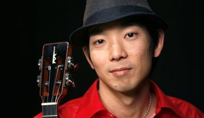 In this Jan. 24, 2011 photo, recording artist Jake Shimabukuro poses for a portrait in New York.  (AP Photo/Jeff Christensen)