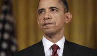 President Obama makes a statement Friday on Libya in the East Room of the White House. (Associated Press)