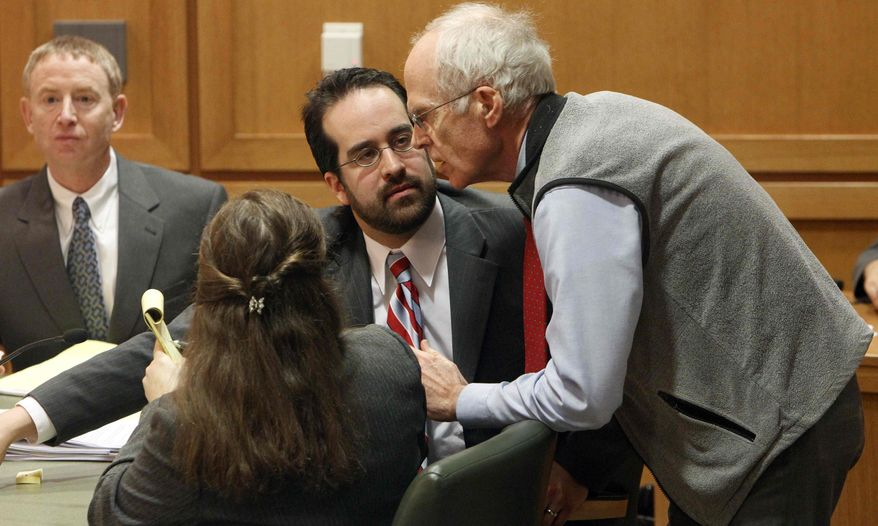 Wisconson Secretary of State Douglas La Follette, right, confers with assistant attorneys general Maria Lazar, foreground, and Steven Kilpatrick, center, after a judge issued a temporary restraining order Friday, March 18, 2011, barring the publication of a controversial new law that would sharply curtail collective bargaining for public employees during a hearing in Dane County Court in Madison, Wis. (AP Photo/Pool, Mark Hoffman)
