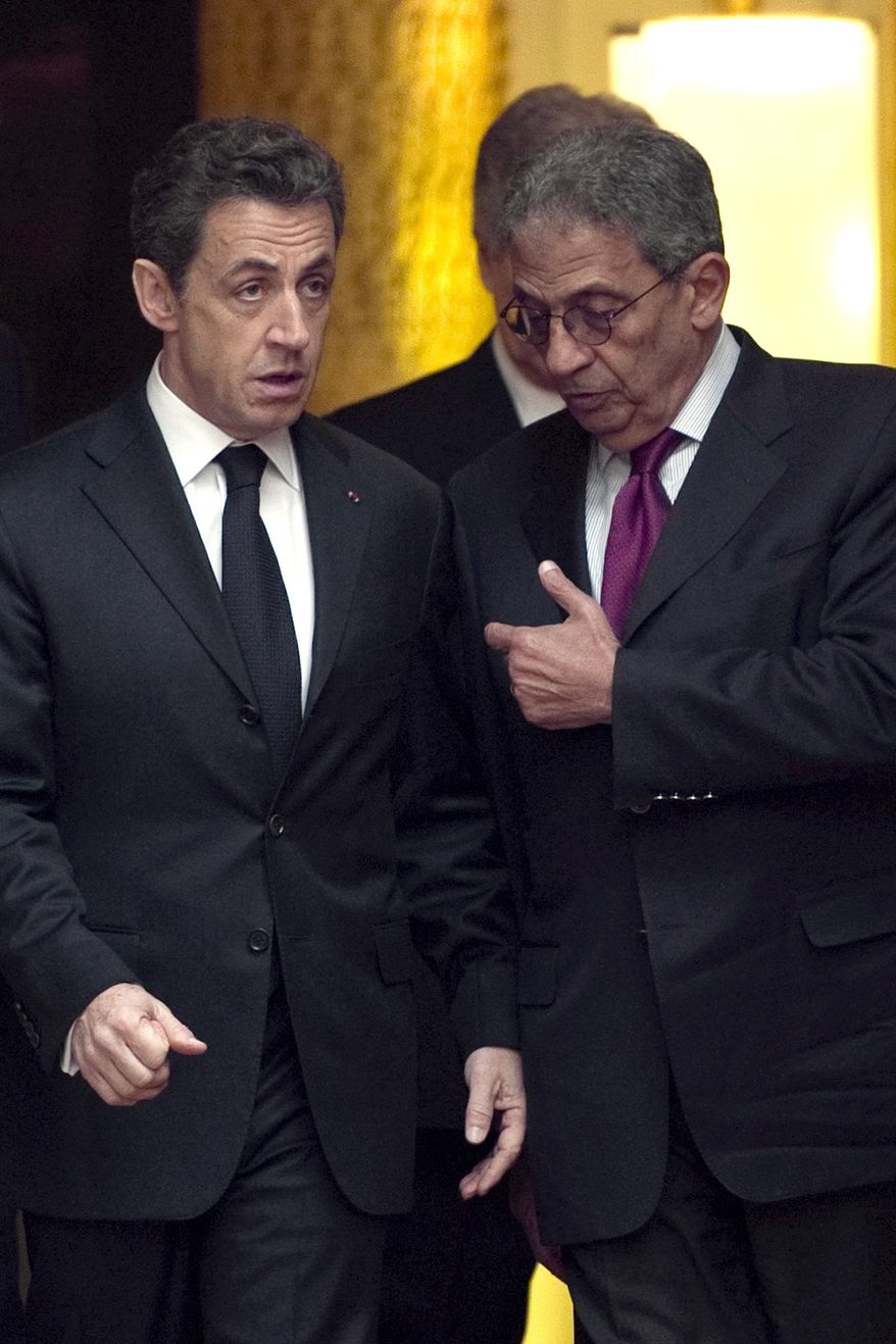French President Nicolas Sarkozy, left, and Arab League Secretary-General Amr Moussa discuss in the Elysee Palace in Paris, during a crisis summit on Libya, Saturday, March, 19, 2011. Britain and France took the lead in plans to enforce a no-fly zone over Libya on Friday, sending British warplanes to the Mediterranean and announcing a crisis summit in Paris with the U.N. and Arab allies. (AP Photo/Lionel Bonaventure, Pool)