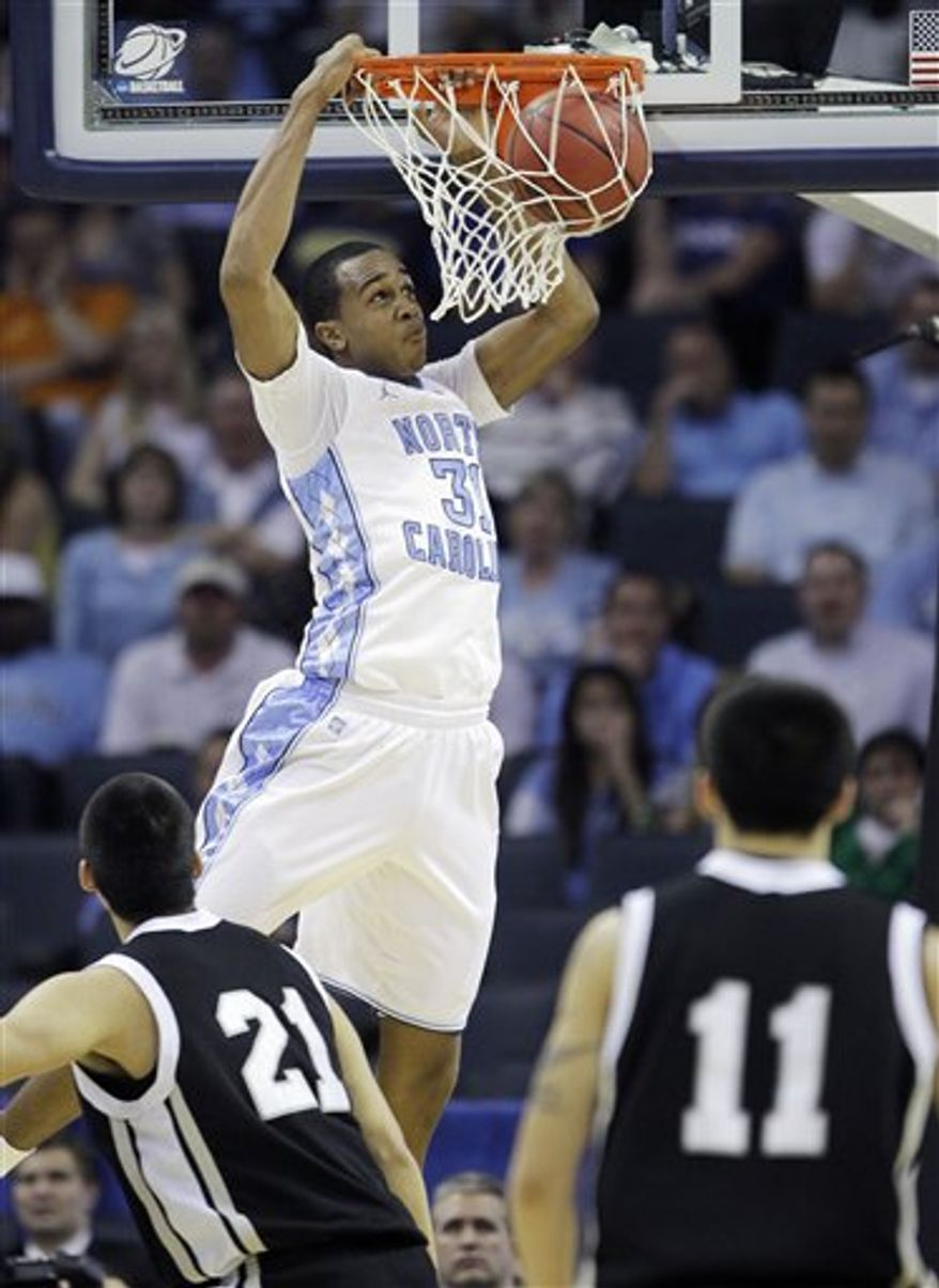 North Carolina forward Tyler Zeller (44) heads to the basket as Long Island forward Kenny Onyechi (32) and Long Island guard C.J. Garner (12) look on in the second half of an East Regional NCAA tournament second-round college basketball game, Friday, March 18, 2011, in Charlotte, N.C. (AP Photo)