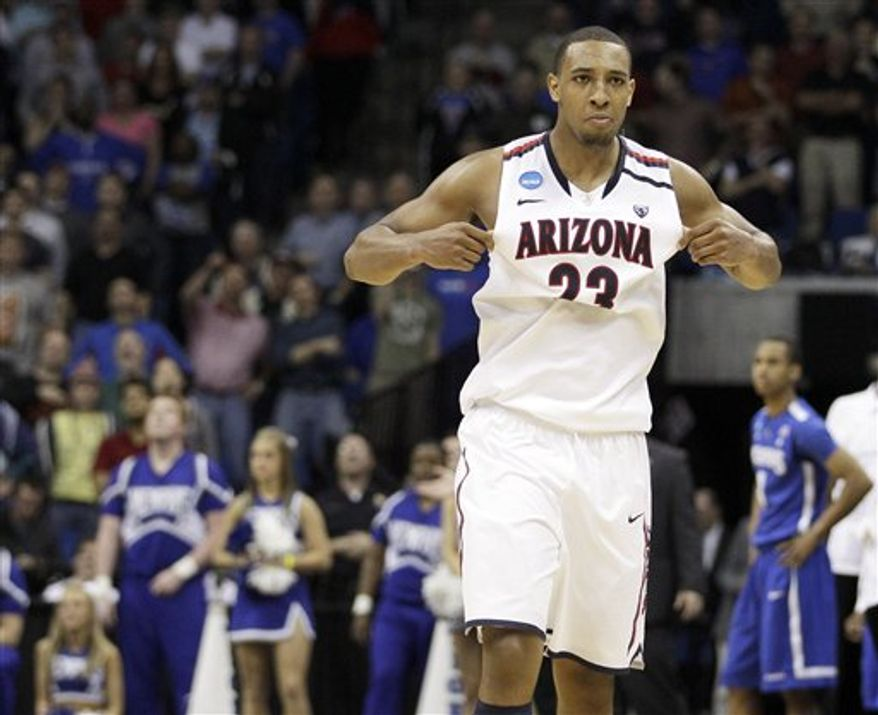Arizona forward Derrick Williams reacts after blocking a shot by Memphis' Wesley Witherspoon's in the final seconds of play at a West Regional NCAA tournament second round college basketball game, Friday, March 18, 2011 in Tulsa, Okla. Arizona won 77-75. (AP Photo/Charlie Riedel)
