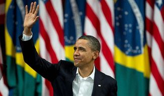 President Obama greets the crowd before delivering a speech at the Municipal Theater in Rio de Janeiro on Sunday. Mr. Obama arrived in Brazil on Saturday for the start of a three-country, five-day tour of Latin America. (Associated Press)