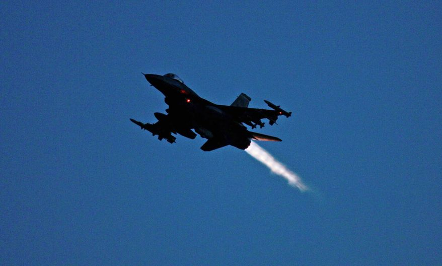 ** FILE ** An F-16 jet fighter flies over the NATO airbase in Aviano, Italy. (Associated Press)