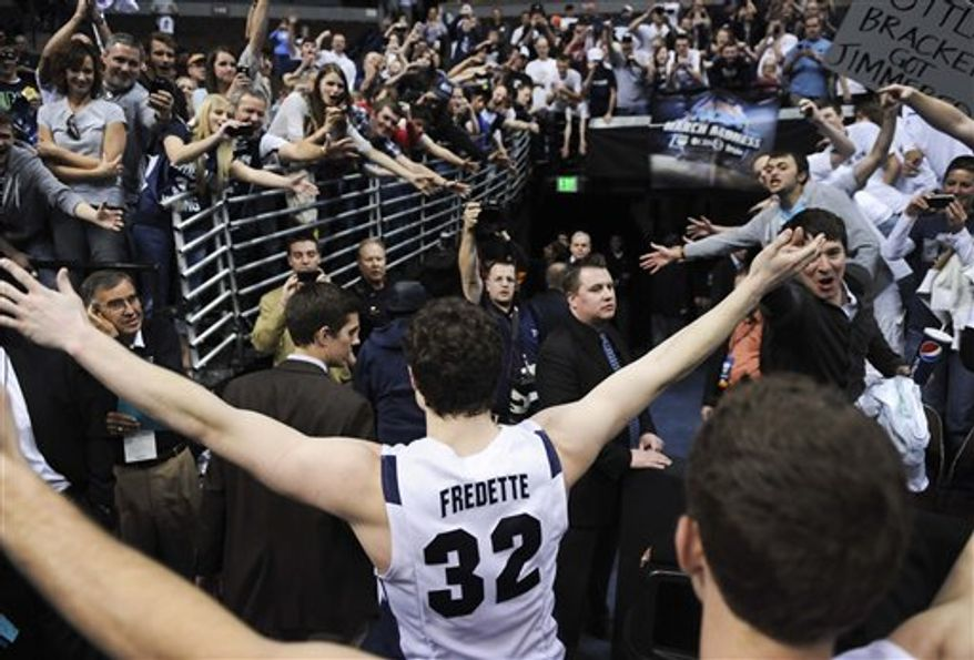 BYU's Jimmer Fredette is greeted by fans as he walks off the court after BYU defeated Gonzaga 89-67 in a Southeast regional third round NCAA tournament college basketball game, Saturday, March 19, 2011, in Denver. (AP Photo/Jack Dempsey)