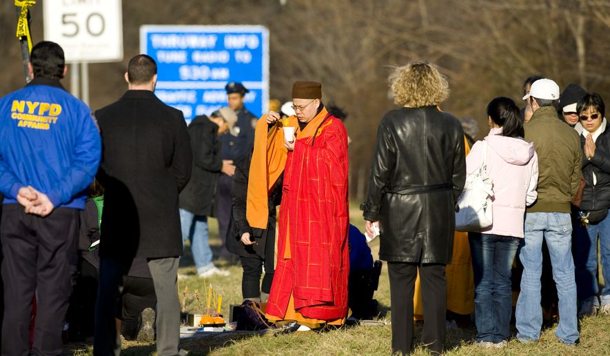 Victims' family members participate in a Buddhist service on Saturday, March 19, 2011, at the site of a March 12 tour bus crash that left 15 people dead in the Bronx borough of New York. (AP Photo/Stephen Chernin)