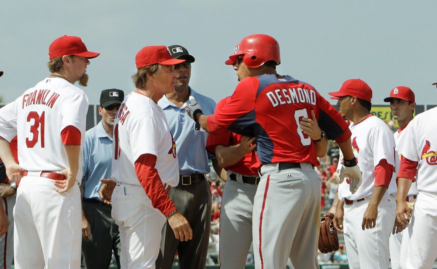 Washington Nationals shortstop Ian Desmond is held after getting hit by a pitch during a spring training game against the St. Louis Cardinals on Monday. Desmond earlier scored on a Laynce Nix triple. (Associated Press)