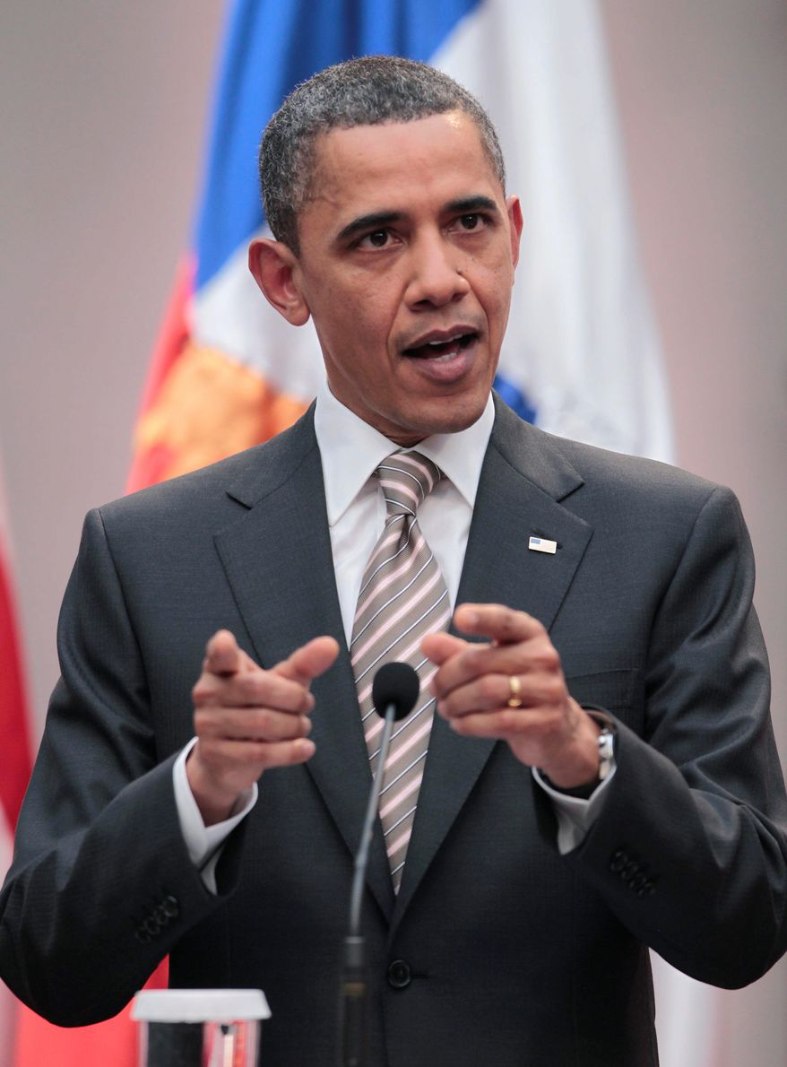 "President Obama said Monday at La Moneda Palace in Santiago, Chile, that it will be a matter of ""days"" before the U.S. turns over leadership of the air attacks on Libya to others. (Associated Press)"