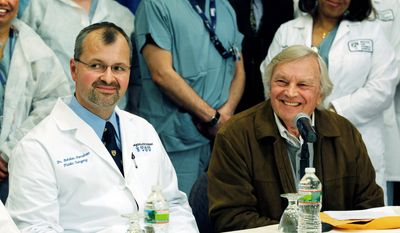 Plastic surgeon Dr. Bohdan Pomahac (left) attends a news conference Monday at Brigham and Women's Hospital in Boston with Del Peterson, grandfather of the nation's first full face transplant recipient Dallas Wiens, 25, of Fort Worth, Texas. (Associated Press)
