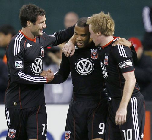 D.C. United's Charlie Davies celebrates with teammates Chris Pontius (left) and Dax McCarty (right) (Associated Press)