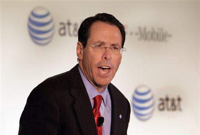 AT&T Chairman, CEO and President Randall Stephenson,addresses a news conference in New York, Monday, March 21, 2011. AT&T Inc. said Sunday it will buy T-Mobile USA from Deutsche Telekom AG in a cash-and-stock deal valued at $39 billion that would make it the largest cellphone company in the U.S. (AP Photo/Richard Drew)