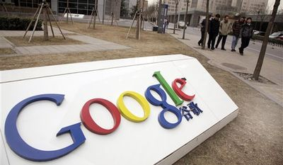 ** FILE ** Pedestrians pass the Google China headquarters in Beijing in March 2010. (AP Photo/Ng Han Guan, File)