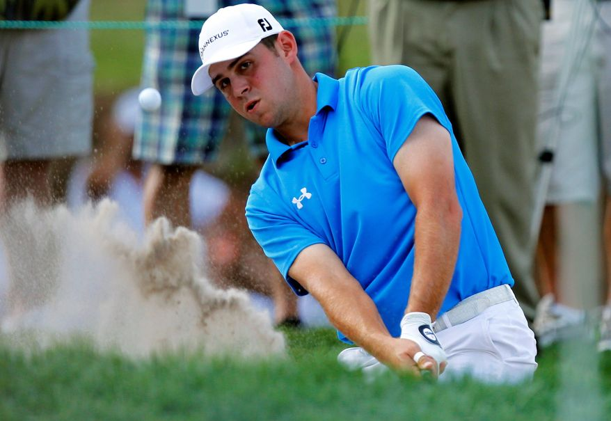 Gary Woodland hits out of the bunker onto the 16th green during the final round of the Transitions Championship golf tournament Sunday in Palm Harbor, Fla. Woodland won the tournament.