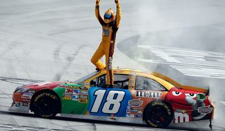 Kyle Busch celebrates after winning the NASCAR Sprint Cup Series auto race at Bristol Motor Speedway on Sunday in Bristol, Tenn.