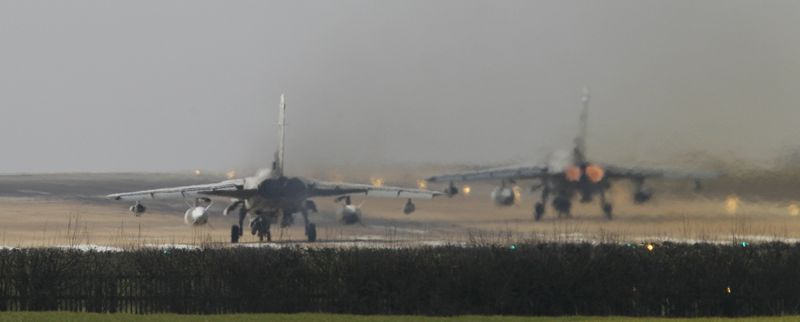 """A British RAF Tornado takes off from RAF Marham, England, Monday, March, 21, 2011. The U.N. Security Council on Thursday approved a resolution backed by the U.S., Britain and France, authorizing the use of """"all necessary measures"""" to protect civilians under attack by government forces in Libya. (AP Photo/Alastair Grant)"""