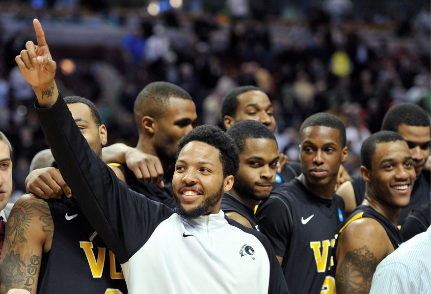 Virginia Commonwealth guard Brandon Rozzell (center) celebrates with teammates after the Rams' 94-76 victory over Purdue on Sunday in Chicago that came after wins over Southern California, 59-46, and Georgetown, 74-56. (Associated Press)