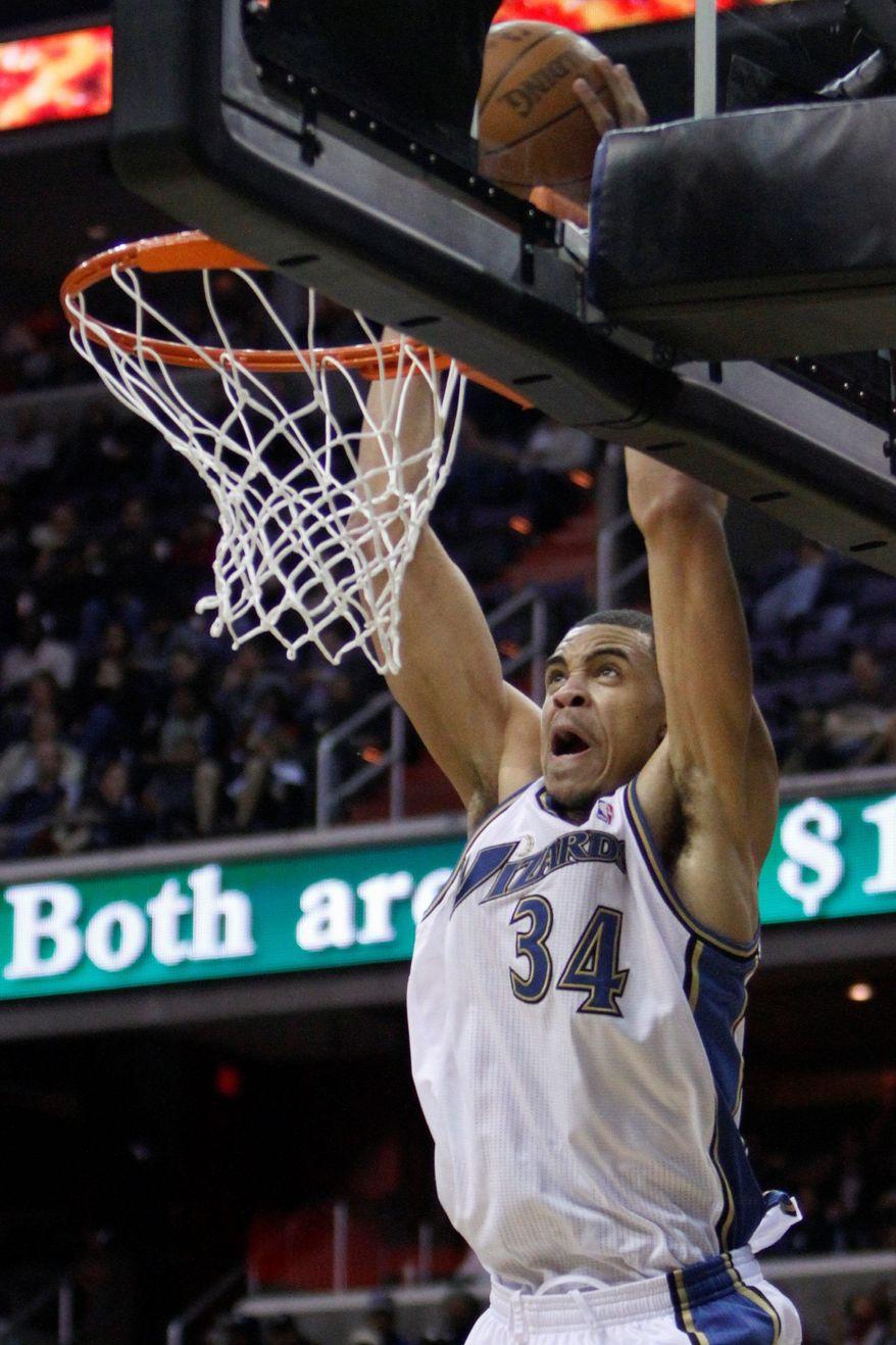 Washington Wizards center JaVale McGee averaged 10.1 points, 8.0 rebounds and 2.4 blocks last season. (Associated Press)