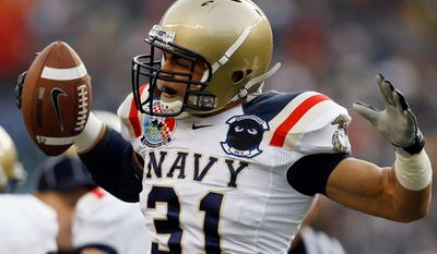 Linebacker Jerry Hauburger celebrates his fumble recovery in last year's Army-Navy game in Philadelphia. A senior, it was his last game as a Midshipman. (Associated Press)