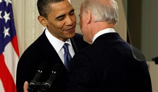 Vice President Biden whispers sweet nothings to President Obama during the health care ceremony at the White House a year ago. (Associated Press)