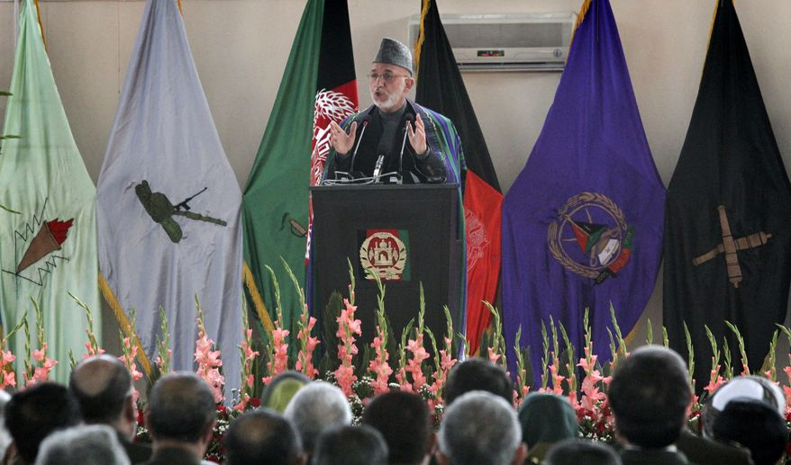 Afghan President Hamid Karzai speaks during a graduation ceremony for Afghan military officers at the National Military Academy of Afghanistan in Kabul, Afghanistan, on Tuesday, March 22, 2011. Mr. Karzai said Afghan security forces soon will take charge of securing seven areas around the country. (AP Photo/Musadeq Sadeq)