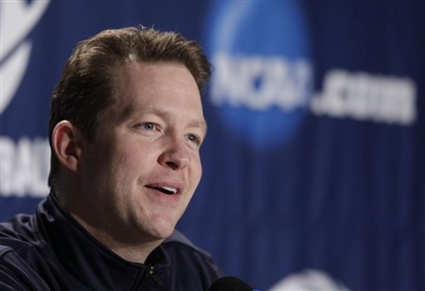 Richmond coach Chris Mooney answers questions during a news conference for the Southwest Regional third-round NCAA tournament college basketball game, Friday, March 18, 2011, in Denver. Morehead State will play Richmond on Saturday. (AP Photo/Julie Jacobson)