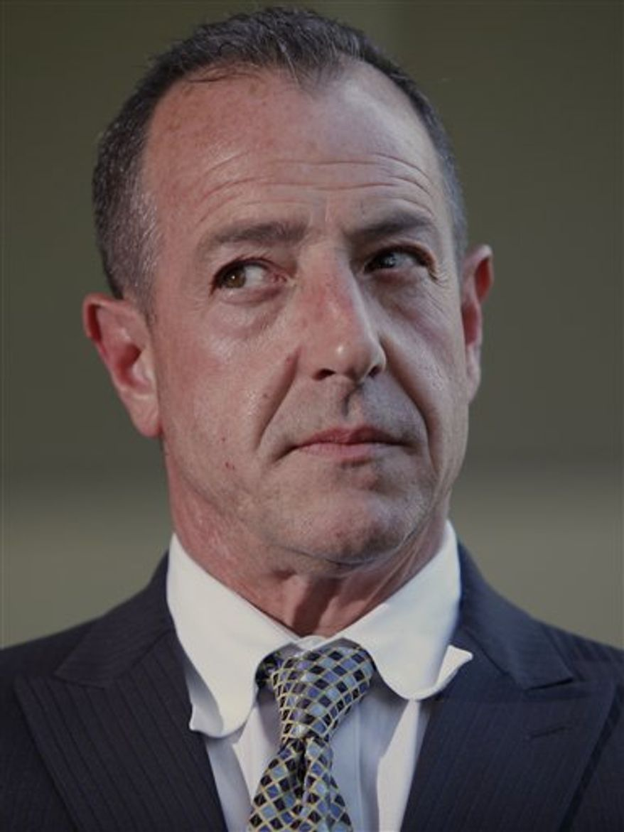 FILE - In this May 20, 2010 file photo, Michael Lohan, father of actress Lindsay Lohan, takes questions about his daughter, after a hearing in Beverly Hills, Calif. Authorities in Los Angeles say Lohan was arrested Monday, March 21, 2011 over allegations he held his girlfriend against her will and prevented her from calling 911. A sheriff's news release says 51-year-old Lohan was booked for investigation of preventing a report of victimization, false imprisonment and infliction of corporal injury on a cohabitant, all felonies. Bail is set at $200,000. (AP Photo/Damian Dovarganes, File)