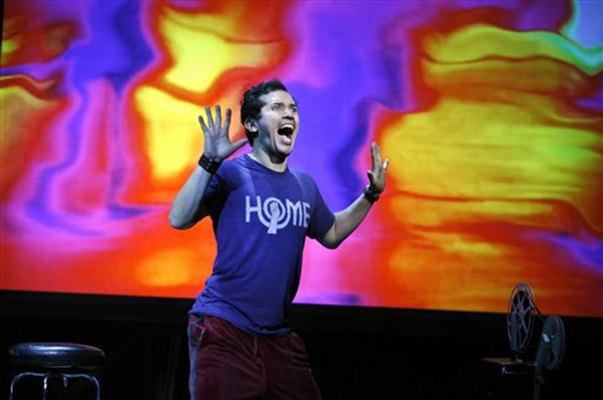 """In this theater publicity image released by Boneau/Bryan-Brown, John Leguizamo is shown during his one-man show, """"Ghetto Klown,"""" at the Lyceum Theatre in New York. (AP Photo/Boneau/Bryan-Brown, Carol Rosegg)"""