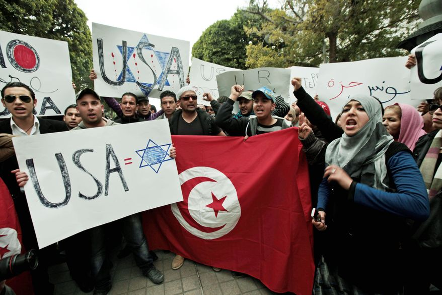Tunisians chant anti-US slogans in Tunis while demonstrating March 16 against the upcoming visit of Secretary of State Hillary Rodham Clinton. She met with Internet activists during her trip. (Associated Press)