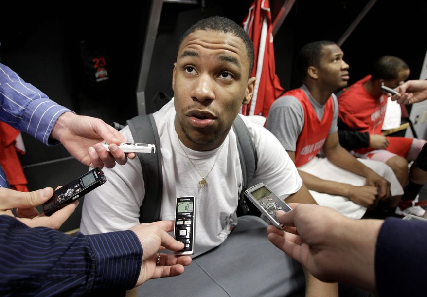 Ohio State freshman Jared Sullinger talks to reporters after practice last week. The forward leads the Buckeyes in scoring this season, averaging 17.1 points a game. (Associated Press)